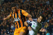 Hatem Ben Arfa of Hull City and Sebastian Blanco of West Bromwich Albion challenge for the ball during the Capital One Cup Third Round match between West Bromwich Albion and Hull City at The Hawthorns on September 24, 2014 in West Bromwich, England.