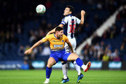 Gareth Barry of West Bromwich Albion is challenged by Calum Butcher of Mansfield Town during the Carabao Cup Second Round match between West Bromwich Albion and Mansfield Town at The Hawthorns on August 28, 2018 in West Bromwich, England.