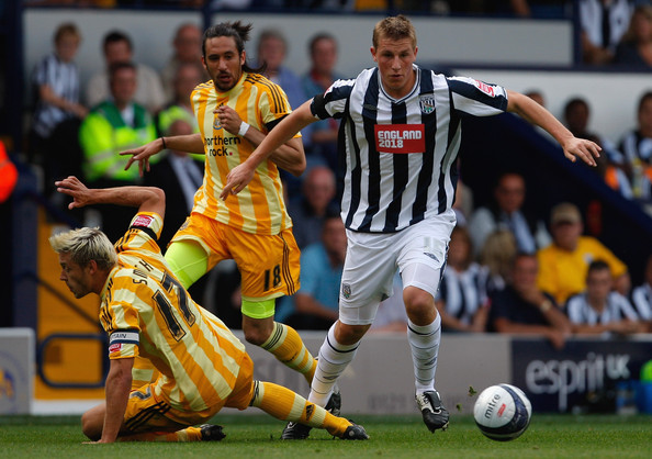 Chris Wood Newcastle captain Alan Smith is beaten to the ball by West Brom striker Chris Wood during the Coca Cola Championship game between West Bromwich Albion and Newcastle United at the Hawthorns on August 8, 2009 in West Bromwich, England.