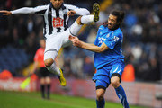 Jonas Gutierrez of Newcastle United is challenged by Gonzalo Jara of West Bromwich Albion during the Barclays Premier League match between West Bromwich Albion and Newcastle United at The Hawthorns on December 5, 2010 in West Bromwich, England.