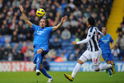 Jonas Gutierrez of Newcastle United attempts to control the ball under pressure from Gonzalo Jara during the Barclays Premier League match between West Bromwich Albion and Newcastle United at The Hawthorns on December 5, 2010 in West Bromwich, England.