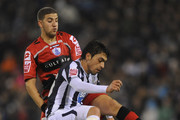 Gonzalo Jara of West Bromwich Albion battles with Adel Taarabt of QPR during the Coca-Cola Championship match between West Bromwich Albion and Queens Park Rangers at The Hawthorns on December 14, 2009 in West Bromwich, England.