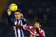 George Thorne of West Bromwich Albion tangles with Ji-Sung Park of Queens Park Rangers during the FA Cup third round replay between West Bromwich Albion and Queens Park Rangers at The Hawthorns on January 15, 2013 in West Bromwich, England.
