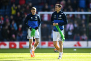 James McClean of West Bromwich Albion and teammate Gareth Barry warm up prior to the The Emirates FA Cup Fifth Round between West Bromwich Albion v Southampton at The Hawthorns on February 17, 2018 in West Bromwich, England.