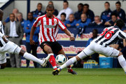 Gonzalo Jara; of West Brom is challenged by Fraizer Campbell of Sunderland during the Barclays Premier League match between Sunderland and West Bromwich Albion at The Hawthorns on August 21, 2010 in West Bromwich, England.