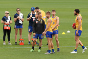 Sam Mitchell shares a moment with Jack Redden, Mark LeCras and Josh Kennedy during a West Coast Eagles AFL training session at Subiaco Oval on September 24, 2018 in Perth, Australia.