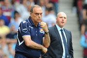 West Ham United manager Avram Grant (L) looks thoughtful as Blackburn Rovers manager Steve Kean looks on during the Barclays Premier League match between West Ham United and Blackburn Rovers at the Boleyn Ground on May 7, 2011 in London, England.