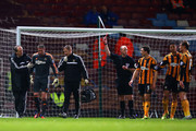 An injured Allan McGregor of Hull City (2L) is shown a red card by Referee Mike Dean during the Barclays Premier League match between West Ham United and Hull City at Boleyn Ground on March 26, 2014 in London, England.