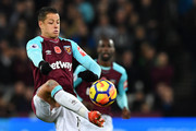 West Ham United's Mexican striker Javier Hernandez controls the ball during the English Premier League football match between West Ham United and Liverpool at The London Stadium, in east London on November 4, 2017. / AFP PHOTO / Ben STANSALL / RESTRICTED TO EDITORIAL USE. No use with unauthorized audio, video, data, fixture lists, club/league logos or 'live' services. Online in-match use limited to 75 images, no video emulation. No use in betting, games or single club/league/player publications.  /