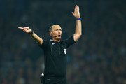 Referee Mike Dean signals during the Barclays Premier League match between West Ham United and Manchester United at the Boleyn Ground on May 10, 2016 in London, England. West Ham United are playing their last ever home match at the Boleyn Ground after their 112 year stay at the stadium. The Hammers will move to the Olympic Stadium for the 2016-17 season.