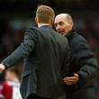 Mike Dean and Garry Monk Photos