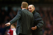Fourth Official Mike Dean speaks to Manager Garry Monk of Swansea City during the Barclays Premier League match between West Ham United and Swansea City at Boleyn Ground on December 7, 2014 in London, England.
