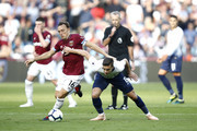 Mark Noble of West Ham United challenges for the ball with Harry Winks of Tottenham Hotspur during the Premier League match between West Ham United and Tottenham Hotspur at London Stadium on October 20, 2018 in London, United Kingdom.