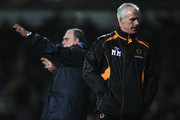 Mick McCarthy, manager of Wolverhampton Wanderers looks dejected as Avram Grant, manager of West Ham United gives instructions during the Barclays Premier League match between West Ham United and Wolverhampton Wanderers at the Boleyn Ground on January 1, 2011 in London, England.