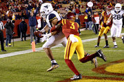 Tight end Trevon Wesco #81 of the West Virginia Mountaineers pulls in the ball for a touchdown as defensive back Mike Johnson #3 of the Iowa State Cyclones defends in the second half of play at Jack Trice Stadium on November 26, 2016 in Ames, Iowa. The West Virginia Mountaineers won 49-19 over the Iowa State Cyclones.