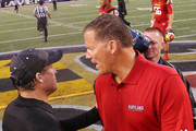 Head coach Dana Holgorsen of the West Virginia Mountaineers shakes hands with head coach Randy Edsall of the Maryland Terrapins following the Terrapins 37-0 win at M&T Bank Stadium on September 21, 2013 in Baltimore, Maryland.