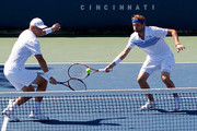 Mardy Fish and Mark Knowles of the Bahamas return a shot to Gael Monfils of France and Philipp Kohlschreiber of Germany during Day 1 of the Western & Southern Financial Group Masters at the Lindner Family Tennis Center on August 16, 2010 in Cincinnati, Ohio.