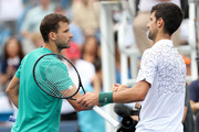 Grigor Dimitrov of Bulgaria congratulates Novak Djokovic of Serbia during the Western & Southern Open at Lindner Family Tennis Center on August 17, 2018 in Mason, Ohio.