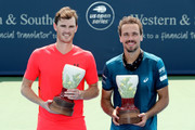 Jamie Murray of Great Britain and Bruno Soares of Brazil pose for photographers after defeating Juan Sebastian Cabal and Robert Farah of Colombia during the men's doubles final of the Western & Southern Open at Lindner Family Tennis Center on August 19, 2018 in Mason, Ohio.