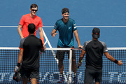 Jamie Murray of Great Britain and Bruno Soares of Brazil pose are congratulated by Robert Farah and  Juan Sebastian Cabal of Colombia during the men's doubles final of the Western & Southern Open at Lindner Family Tennis Center on August 19, 2018 in Mason, Ohio.