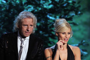 TV host Thomas Gottschalk (L) and TV host Michelle Hunziker attend the 198th 'Wetten, dass ...?' show at Messe Leipzig on November 05, 2011 in Leipzig, Germany.