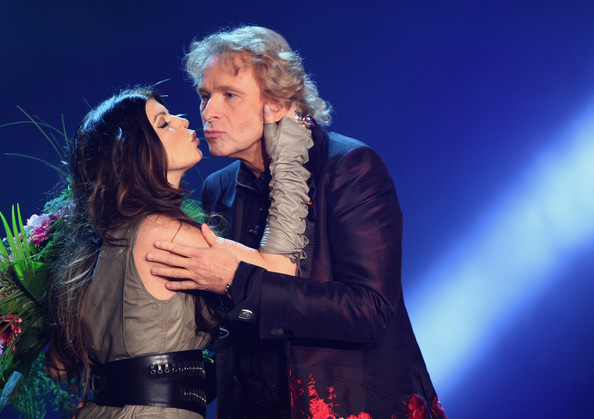 Host Thomas Gottschalk hands over flowers to Fergie of The Black Eyed Peas during the 'Wetten dass...?' show at the Volkswagenhalle on November 7, 2009 in Braunschweig, Germany.