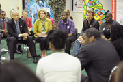 Mayor Cory Booker (L) and Musician Jon Bon Jovi (2nd R) talk with Newark students during the White House Council for Community Solutions Youth Listening Session at the Youth Success Center of Newark on June 6, 2011 in Newark, New Jersey.