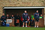 Lincoln City Manager Chris Moyses (c) looks on during the Emirates FA Cup First Round match between Whitehawk FC and Lincoln City at The Enclosed Ground on November 8, 2015 in Brighton, England.