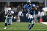 Calvin Johnson and Brandon Carr Photos Photo