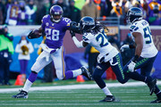 Adrian Peterson #28 of the Minnesota Vikings stiff arms Richard Sherman #25 of the Seattle Seahawks in the second half during the NFC Wild Card Playoff game at TCFBank Stadium on January 10, 2016 in Minneapolis, Minnesota.