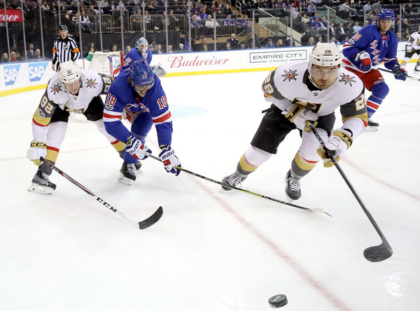 Vegas Golden Knights v New York Rangers [college ice hockey,ice hockey,sports,hockey,hockey protective equipment,team sport,sports gear,player,ice rink,ice hockey position,tomas nosek,william carrier,marc staal,puck,madison square garden,new york city,golden knights,new york rangers,game]