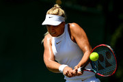 Sabine Lisicki of Germany plays a backhand against Anna Kalinskaya of Russia during Wimbledon Championships Qualifying - Day 2 at The Bank of England Sports Centre on June 26, 2018 in London, England.