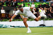 Pat Cash of Australia returns a shot during his men's doubles match between Jamie Murray of Great Britain and Goran Ivanisevic of Croatia and Lleyton Hewitt of Australia and Pat Cash of Australia during the Wimbledon No. 1 Court Celebration in support of the Wimbledon Foundation at All England Lawn Tennis and Croquet Club on May 19, 2019 in London, England.