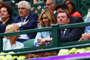 Katherine Jenkins and her husband Andrew Levitas speak with Gill Brook and her husband Philip Brook, chairman of the All England Lawn Tennis and Croquet Club during the Wimbledon No. 1 Court Celebration in support of the Wimbledon Foundation at All England Lawn Tennis and Croquet Club on May 19, 2019 in London, England.