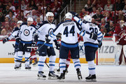 Tobias Enstrom and Dustin Byfuglien Photos Photo