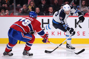 Blake Wheeler #26 of the Winnipeg Jets shoots the puck on net in front of Andrei Markov #79 of the Montreal Canadiens during the NHL game at the Bell Centre on November 11, 2014 in Montreal, Quebec, Canada.  The Canadiens defeated the Jets 3-0.