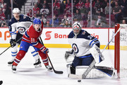 Goaltender Steve Mason #35 of the Winnipeg Jets makes a stick save near Brendan Gallagher #11 of the Montreal Canadiens during the NHL game at the Bell Centre on April 3, 2018 in Montreal, Quebec, Canada.