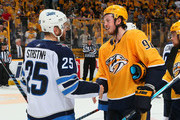 Ryan Johansen #92 of the Nashville Predators congratulates Paul Stastny #25 of the Winnipeg Jets after a 5-1 Jets Victory in Game Seven of the Western Conference Second Round during the 2018 NHL Stanley Cup Playoffs at Bridgestone Arena on May 10, 2018 in Nashville, Tennessee.