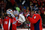 Goalie Braden Holtby #70 and Alex Ovechkin #8 of the Washington Capitals celebrate after the Capitals defeated the Winnipeg Jets 5-3 at Verizon Center on November 25, 2015 in Washington, DC.