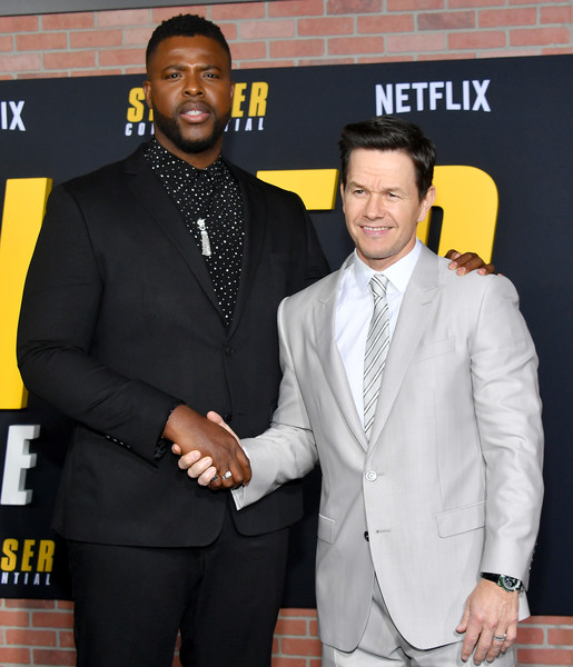 "Premiere Of Netflix's ""Spenser Confidential"" - Arrivals [suit,premiere,event,formal wear,tuxedo,award,tie,white-collar worker,carpet,blazer,arrivals,mark wahlberg,spenser confidential,l-r,california,regency village theatre,netflix,winston duke,westwood,premiere,celebrity,public relations,socialite,tuxedo m.,tuxedo,carpet,netflix,public]"