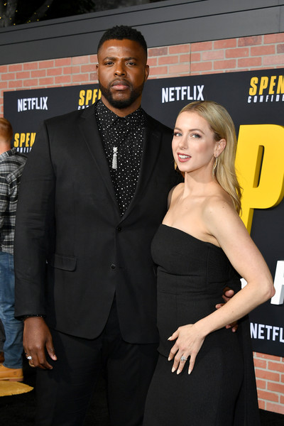 "Premiere Of Netflix's ""Spenser Confidential"" - Arrivals [suit,premiere,little black dress,dress,event,formal wear,tuxedo,carpet,muscle,flooring,arrivals,iliza shlesinger,spenser confidential,l-r,california,regency village theatre,netflix,winston duke,westwood,premiere,celebrity,red carpet,public relations,socialite,tuxedo m.,carpet,tuxedo,netflix,red]"