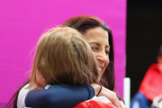 Lizzy Yarnold of Great Britain celebrates with Shelley Rudman of Great Britain (R) after winning the gold medal during the Women's Skeleton on Day 7 of the Sochi 2014 Winter Olympics at Sliding Center Sanki on February 14, 2014 in Sochi, Russia.