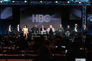 (L-R) Kim Benabib, Co-Executive Producer; actors Maribeth Monroe, Carla Gugino, Aasif Mandvi, Roberto Benabib, ..Executive Producer; Jerry Weintraub, Executive Producer; Jay Roach, Executive Producer/Director; actors Jack Black, Tim Robbins and Pablo Schreiber speaks onstage during 'The Brink' panel at the HBO portion of the 2015 Winter Television Critics Association press tour at the Langham Hotel on January 8, 2015 in Pasadena, California.