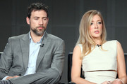 Actors Adam Rayner and Jennifer Finnigan of the television show 'Tyrant' speak onstage during the FX portion of the 2014 Television Critics Association Press Tour at the Langham Hotel on January 14, 2014 in Pasadena, California.
