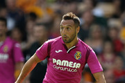 Santi Cazorla of Villareal runs with the ball during the pre-season friendly match between Wolverhampton Wanderers and Villareal at Molineux on August 4, 2018 in Wolverhampton, England.