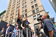 (L-R) United States Soccer Federation president Carlos Cordeiro, Alex Morgan and Allie Long celebrate while riding on a float during The U.S. Women's National Soccer Team Victory Parade and City Hall Ceremony down the Canyon of Heroes on July 10, 2019 in New York City. The team defeated the Netherlands 2-0 Sunday in France to win the 2019 Women's World Cup.