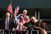 (l-R) President of the USA Soccer Federation Carlos Cordeiro, New York Mayor Bill de Blasio, his Wife Chirlane McCray, Megan Rapinoe, Allie Long, and Alex Morgan celebrate during the U.S. Women's National Soccer Team Victory Parade and City Hall Ceremony on July 10, 2019 in New York City.