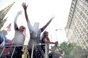 (L-R) United States Soccer Federation president Carlos Cordeiro, Megan Rapinoe, Allie Long and Alex Morgan celebrate while riding on a float during The U.S. Women's National Soccer Team Victory Parade and City Hall Ceremony down the Canyon of Heroes on July 10, 2019 in New York City.
