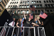 Megan Rapinoe, and Allie Long celebrate during the U.S. Women's National Soccer Team Victory Parade and City Hall Ceremony on July 10, 2019 in New York City.
