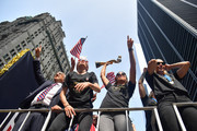 (L-R) United States Soccer Federation president Carlos Cordeiro, Megan Rapinoe, Alex Morgan and Allie Long celebrate while riding on a float during The U.S. Women's National Soccer Team Victory Parade and City Hall Ceremony down the Canyon of Heroes on July 10, 2019 in New York City.